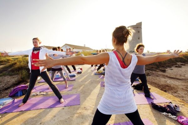 Women do yoga in  El Palmar