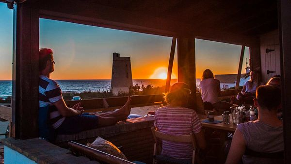 Sunset on terrace with guests of the A Frame Surfcamp