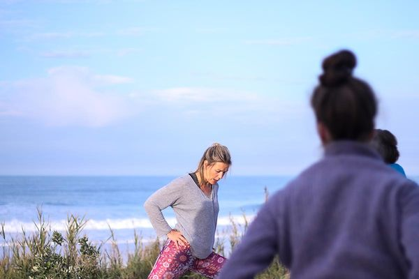 Yoga at the beach in El Palmar in Spain