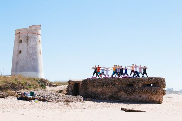 Yoga El Palmar on the rock by the sea