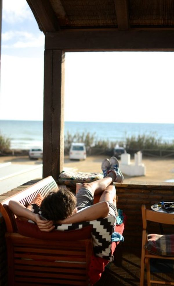 Relax on the balcony and listen to the waves at A Frame Surfcamp