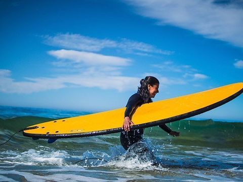 Participate in a surf course during your yoga holiday